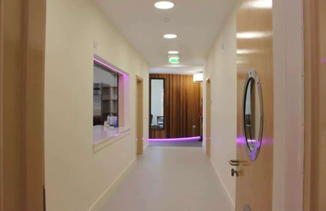 Beige coloured hallway with Purple strip lights