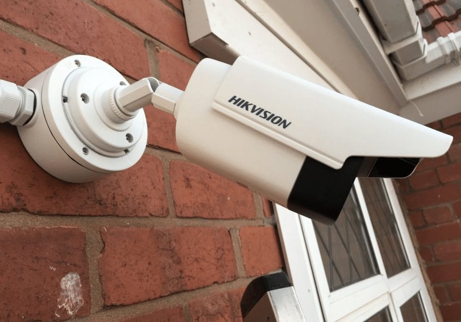 White Hivision camera installed on a home property